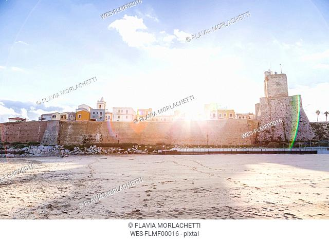 Italy, Molise, Termoli, Old town and Castello Svevo against the sun
