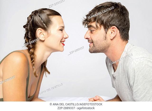 Mid-adult couple looking each other