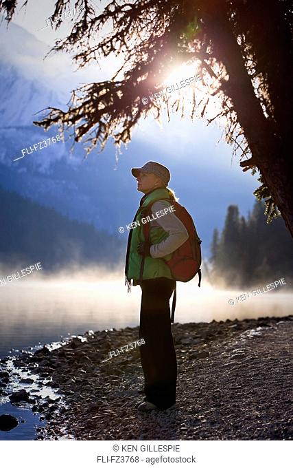 Hiker on misty fall morning, Maligne Lake, Jasper National Park, Alberta