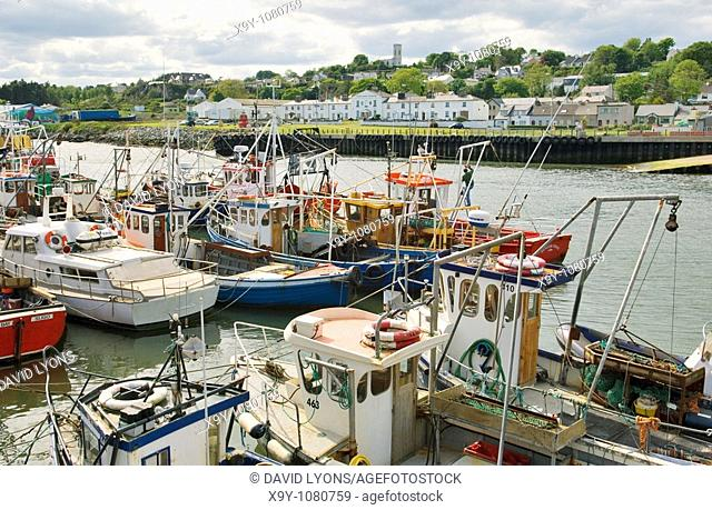 Fishing boats in the port harbour of Greencastle on the Inishowen shore of Lough Foyle in north Donegal, Ireland