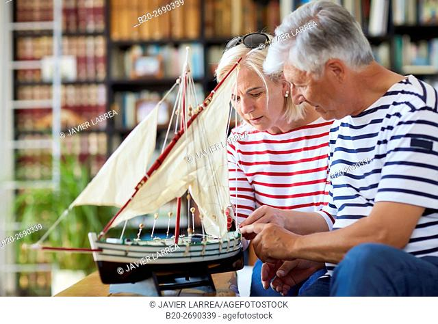 Senior couple, 60-70, building model sailboat, Whaleship, Getaria, Gipuzkoa, Basque Country, Spain, Europe