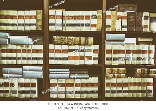 Bookshelf plenty of old legal books. Library law background