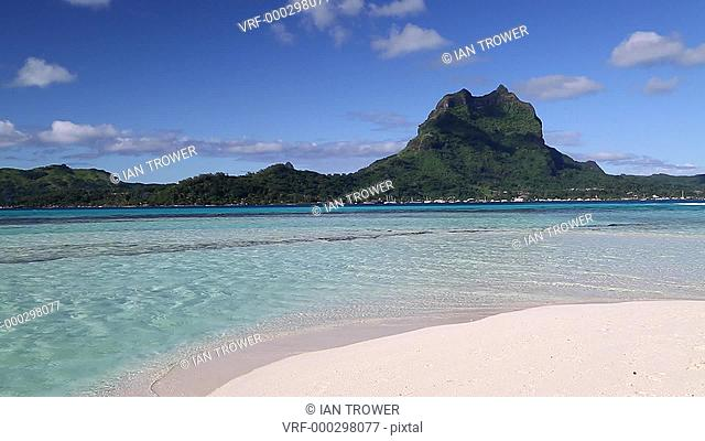 Woman on Motu Tapu, Bora Bora, Society Islands, French Polynesia