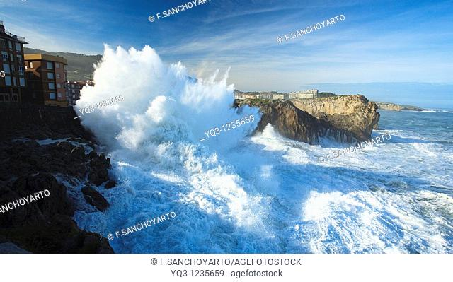 Northwestern waves breaking against buildings during storm. Castro Urdiales, Cantabria, Northern Spain