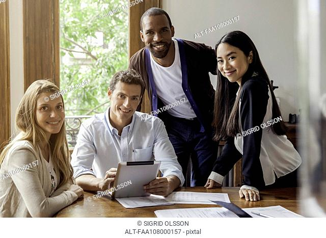 Team of professionals in casual office, portrait