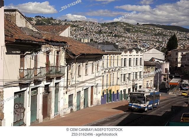 Trolley bus in front of the colonial buildings near Plaza Santo Domingo Square at the historic center, Quito, Ecuador, South America