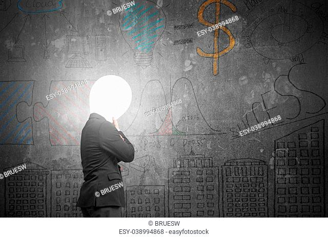 Thinking businessman with lamp head illuminated the dark business concept doodles concrete wall background