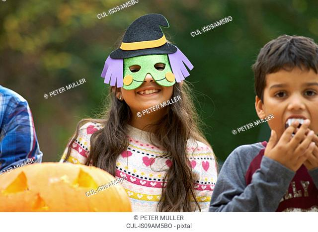 Girl wearing mask over head