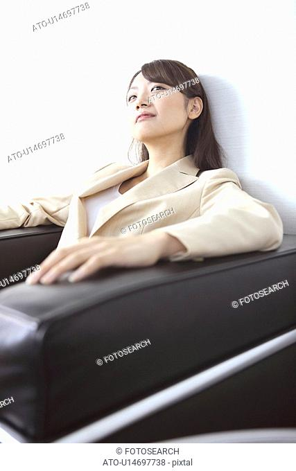 Office lady sitting on a sofa