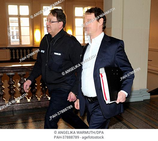 Defendant Thomas S. (R) is brought to court in handcuffs at the district court in Hamburg, Germany, 05 March 2013. Two men are charged with with commercial...