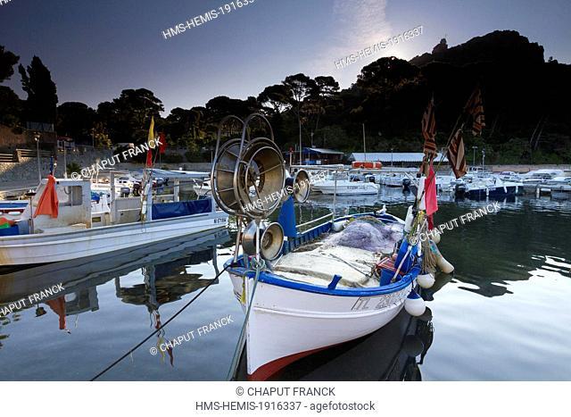 France, Var, Corniche de l'Esterel, Saint Raphael, fishing boat in the Poussaï harbour at the bottom of Cap du Dramont semaphore