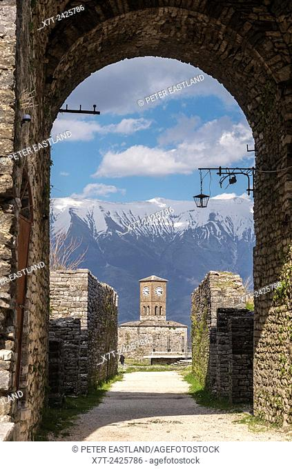 The clocktower at Gjirokastra castle with the Lunxheria mountains in the background, Southern Albania