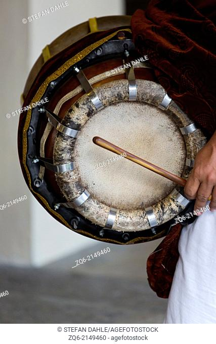 Drummer in the Sri Mariamman Temple in Singapore