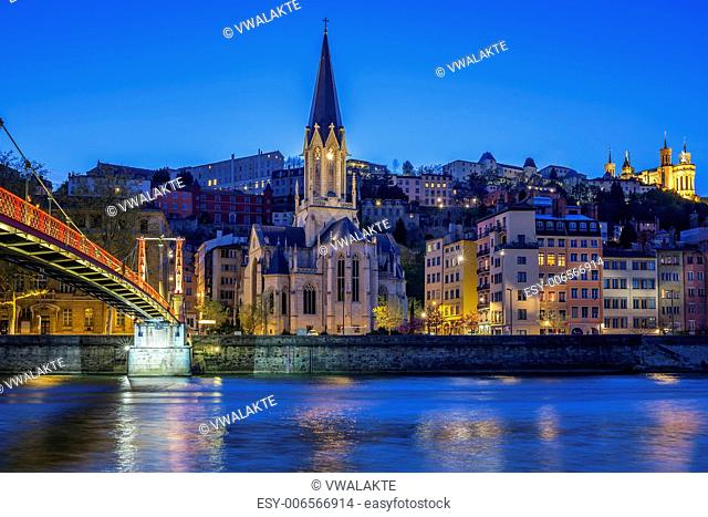 Famous church in Lyon with Saone river at night