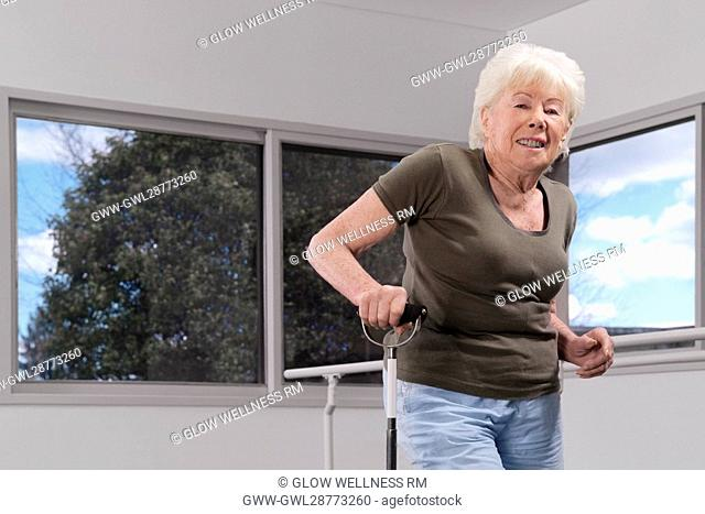 Disabled woman walking with a cane