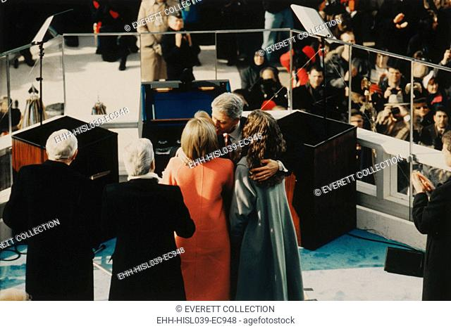 President Bill Clinton embraces his wife, Hillary, and daughter, Chelsea. Jan. 20, 1997, after taking the oath of office for his second term