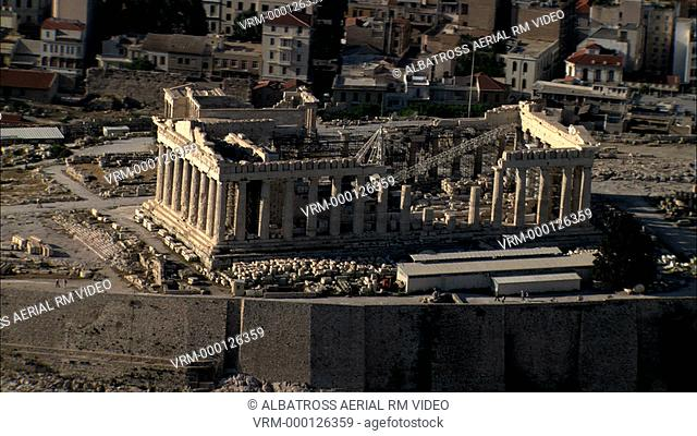 Aerial HD video of the Acropolis focusing on the Parthenon the house of the goddess Athena