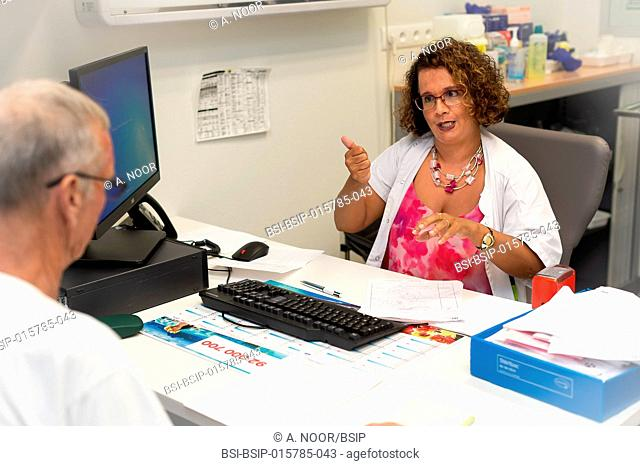 Care for deaf patients in sign language, Nice Hospital, France. Consultation for a man who is over 70 and very sporty. He oralises very well because he followed...