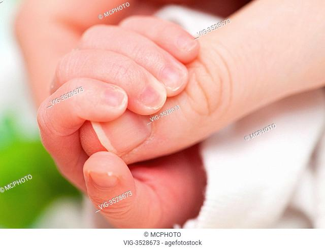 baby holding mothers finger - 11/02/2010