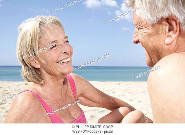 Spain, Mallorca, Happy senior couple at beach