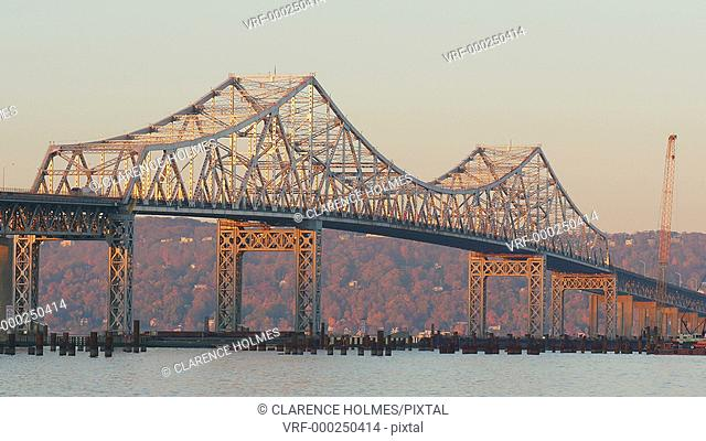 Traffic crosses the Tappan Zee Bridge, bathed in early morning light, over the Hudson River between Westchester and Rockland counties
