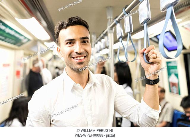 Portrait of smiling businessman in the subway