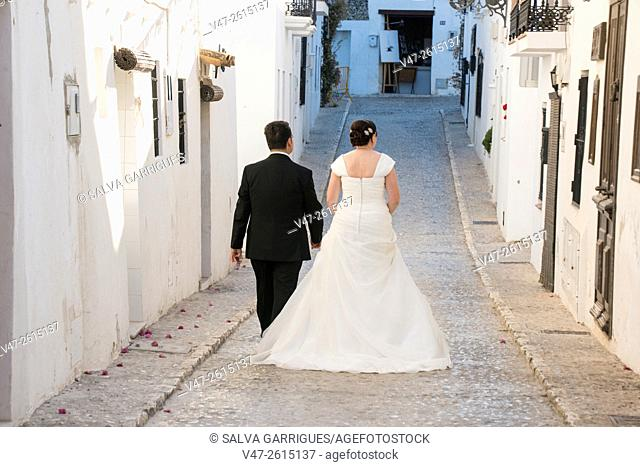 Grooms walking the streets of Altea on their wedding day, Altea, Alicante, Valencia, Spain, Europe