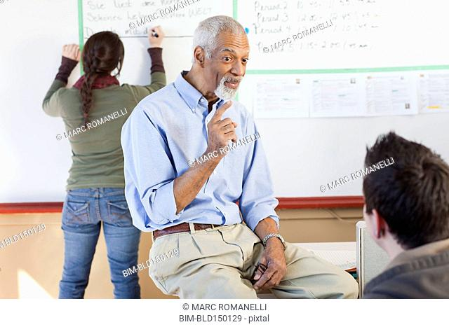 Teacher and students talking in classroom