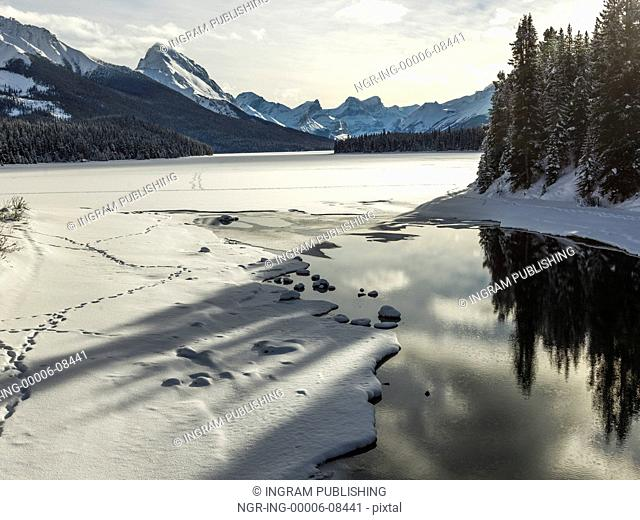 View of snow covered lake, Improvement District No. 12, Maligne Lake, Jasper, Jasper National Park, Alberta, Canada