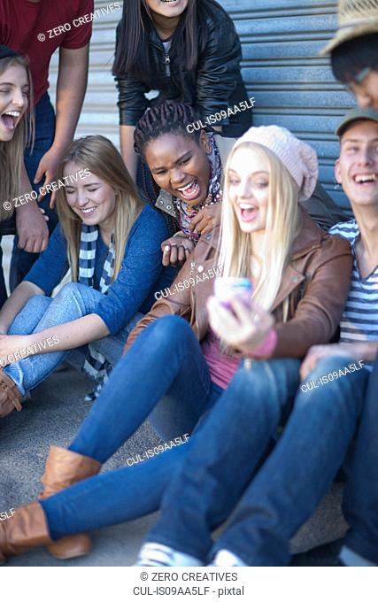 Group of teenagers fooling about