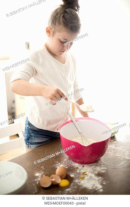 Little girl baking in the kitchen