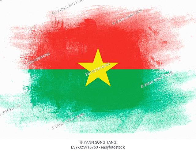 Flag of Burkina Faso painted with brush on solid background