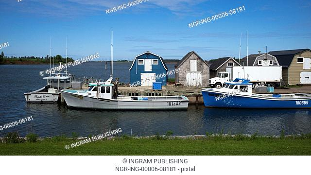 Fishing sheds and boats at dock, Green Gables, Prince Edward Island, Canada