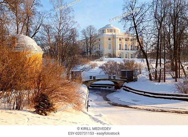 Winter view of the Big palace through park trees. Pavlovsk, St.Petersburg, Russia