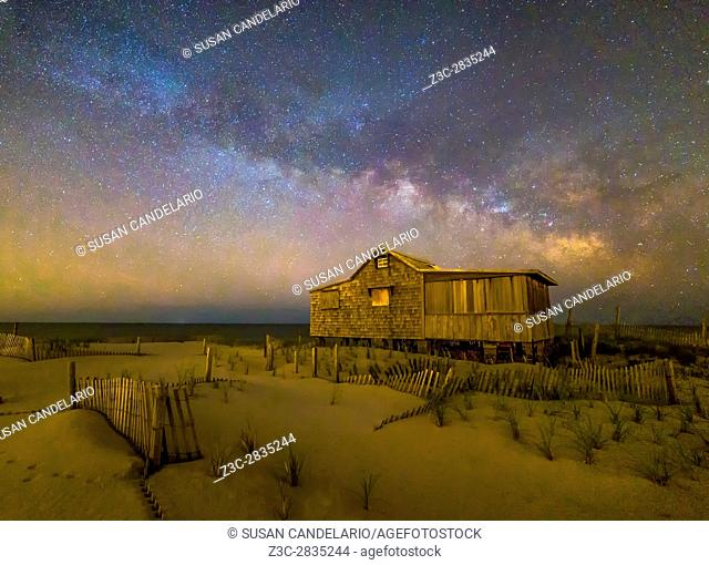 New Jersey Shore Starry Skies and Milky Way - Island Beach State Park at the NJ Shore with beach fences leading to the Judge's Shack underneath a starry sky...
