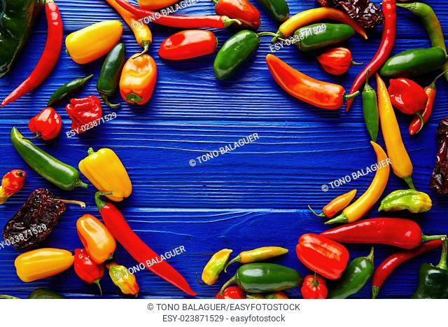 Mexican hot chili peppers colorful mix habanero poblano serrano jalapeno blue background