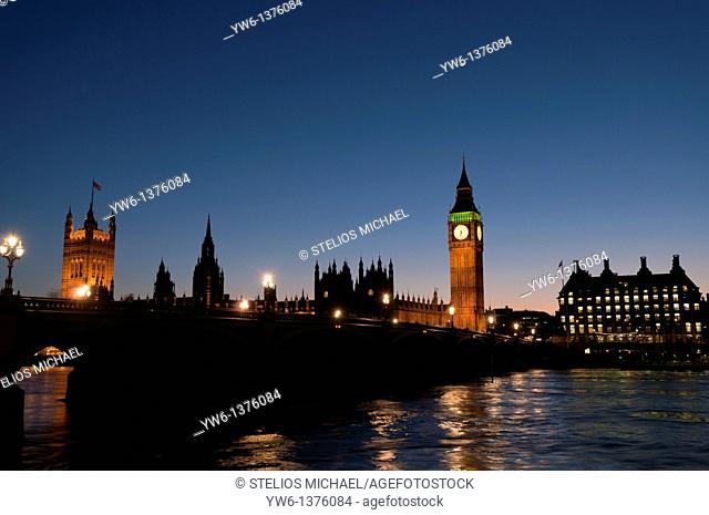 Palace of Westminster and Portcullis House during evening twilight, London,England