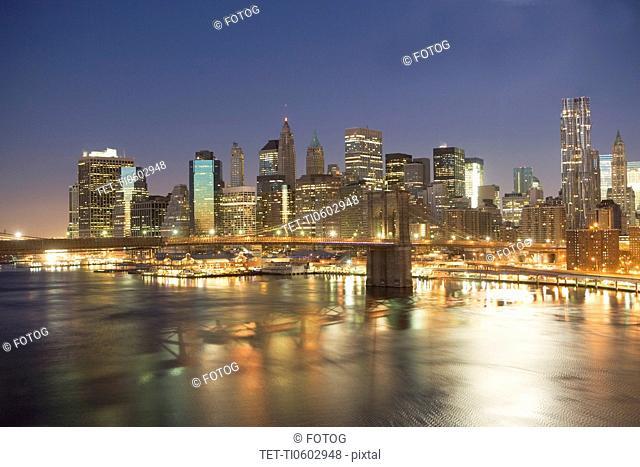 USA, New York state, New York city, Brooklyn Bridge with cityscape at night