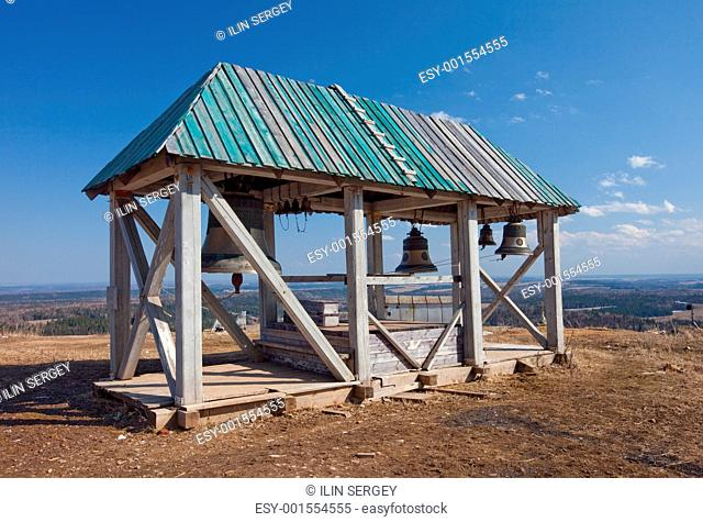 Old wooden belltower. Russia. Perm. White mountain