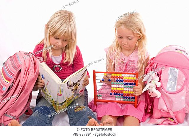 two schoolgirls with book and abacus. - 04/09/2008