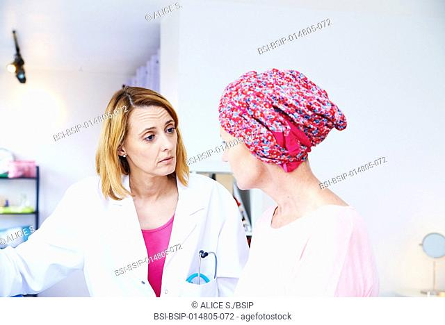 Woman suffering from cancer talking to her doctor