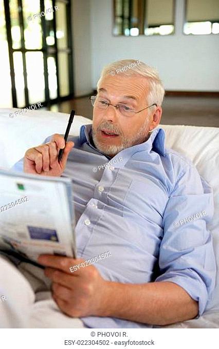 retiree playing crosswords