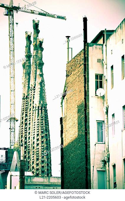 Temple of the Sagrada Familia by Antoni Gaudí between buildings. Barcelona, Catalonia, Spain