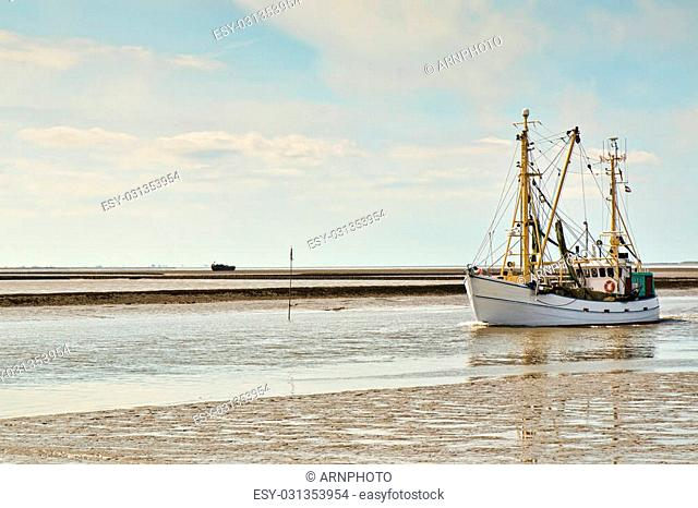 Fishing vessel entering the port at Husum, Germany