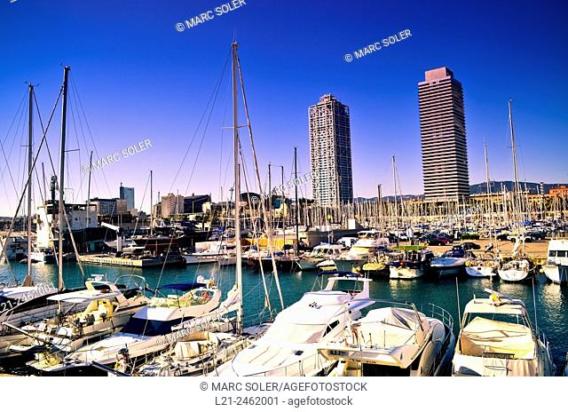 Yachts at Olympic port. Mapfre tower and Hotel Arts near Olympic harbour. Olympic Village, Barcelona, Catalonia, Spain