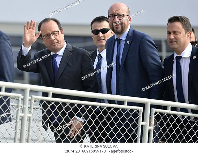 French President Francois Hollande (left) and Belgian Prime Minister Charles Michel (2nd right) take part in EU summit. Statesmen left for working luncheon on...