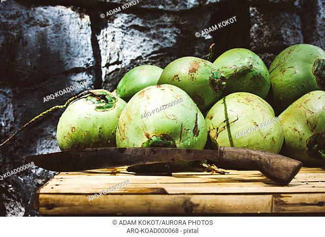 Stack Of Coconuts With Machete