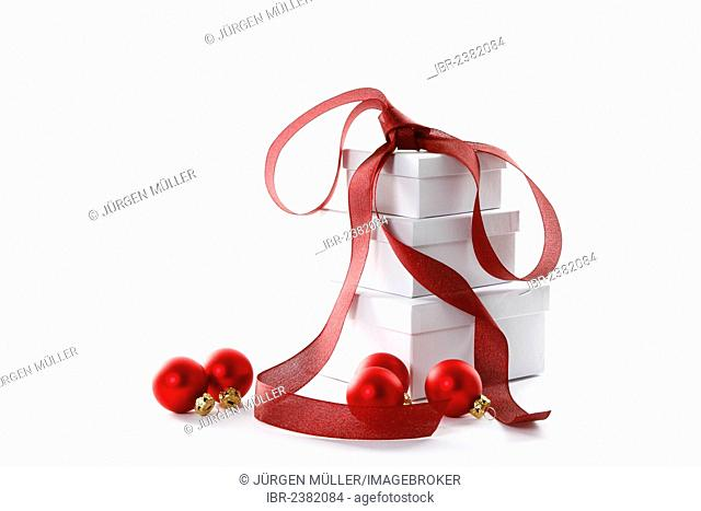 Red Christmas baubles and presents with a red ribbon