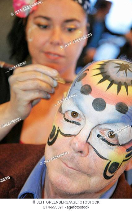 Canada, Quebec City, Upper Town, Hilton Hotel, reception, party, painted faces, female artist, senior male