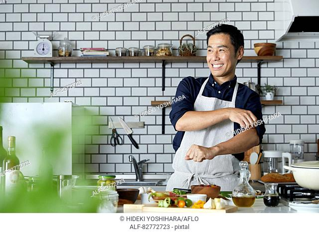 Japanese mature man in the kitchen